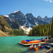 Canoes On A Jetty At  Moraine Lake In Banff National Park, Canada Art Print