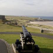 Canon Defends Bamburgh Castle Art Print
