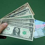 Close-up Of Man's Hand With Us Banknotes And Euro Banknotes Art Print