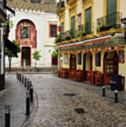 Cobblestone Argote De Molina Street With Cafe Ending At The Nort Art Print