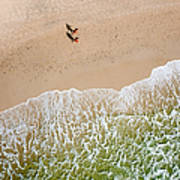 Couple Walking On Tallow Beach Art Print