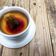 Cup Of Hot Tea On Wood Table Art Print