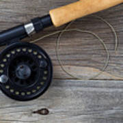 Fly Fishing Reel And Line On Rustic Wood  Art Print