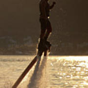 Flyboarder And Water Droplets Backlit At Sunset Art Print