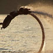 Flyboarder Doing Back Flip Over Backlit Waves Art Print