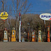 Gas Pumps And Gas Signs Panorama Art Print