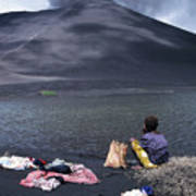 Girl Washing Clothes In A Lake With The Mount Yasur Volcano Emitting Smoke In The Background Art Print by Sami Sarkis
