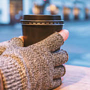 Gloved Hands Holding Coffee Cup Art Print