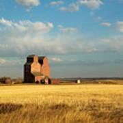 Grain Elevators Stand In A Prairie Art Print