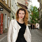 Grinning Attractive Woman Standing On Cobblestone Street Of Uppe Art Print