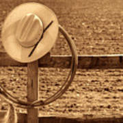 Hat And Lasso On A Fence Art Print