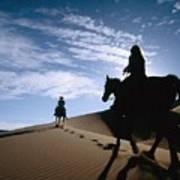 Horseback Riders In Silhouette On Sand Art Print