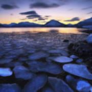 Ice Flakes Drifting Against The Sunset Art Print by Arild Heitmann