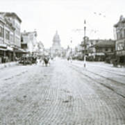 In This Historical 1913 Photo, Horse Drawn Carriages In Downtown Austin, Texas Run Up And Down Congress Avenue Cobblestone Streets Leading Up The The Texas State Capitol Art Print