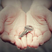 Key In Woman's Hand In Gesture Of Giving. Concept Of Success In Live, Business Solution, Real Estate Etc Art Print