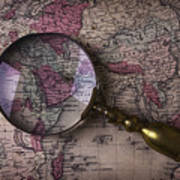 Magnifying  Glass On Old Map Art Print