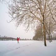 Man In Red Taking Picture Of Snowy Field And Trees Art Print