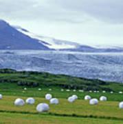 Meadow With Hay Bales And Glaciers Near Jokulsarlon Lagoon In Iceland Art Print