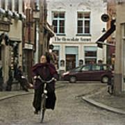 Nun On A Bicycle In Bruges Art Print