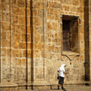 Nun Walking In Front Of Cathedral Art Print