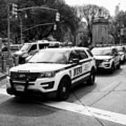 nypd police patrol vehicles parked at columbus circle New York City USA Art Print
