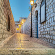 Old Stone Alleyway With Electric Lights Print by Noam Armonn