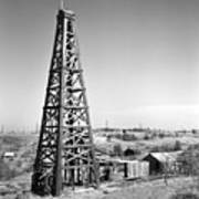 Old Wooden Derrick Print by Larry Keahey