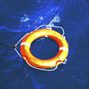 Orange Life Buoy In Blue Water Art Print
