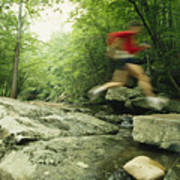 Panned View Of Man Leaping Over Rocky Art Print by Skip Brown