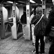 passengers moving through exit turnstiles in subway station New York City USA Art Print