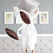Playful Young Woman Jumping On The Bed , A Pillow Fight Art Print