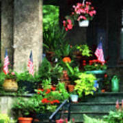 Porch With Geraniums And American Flags Art Print