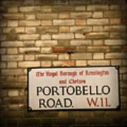 Portobello Road Sign On A Grunge Brick Wall In London England Art Print
