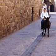 Riding A Donkey Art Print