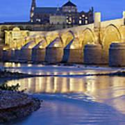 Roman Bridge On Guadalquivir River At Dawn Art Print