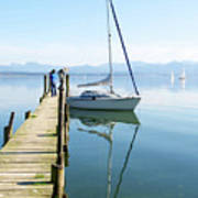 Sailing Boat And Reflection By Lake Pier Art Print