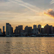 Seagull Flying At Sunset With The Skyline Of Boston On The Backg Art Print