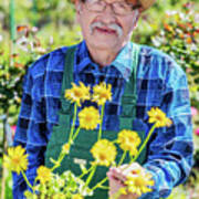 Senior Gardener Showing A Potted Flower. Art Print