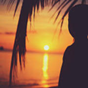 Silhouette Of A Young Boy Watching Beautiful Caribbean Sunset Art Print