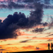 Silhouettes Of Three Girls Walking In The Sunset Art Print