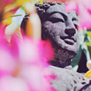 Stone Carved Statue Of Buddha Surrounded With Colorful Flowers Bali, Indonesia Art Print