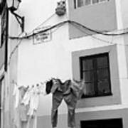 street in Porto with hanging clothes Art Print