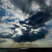 Sun Rays Through Clouds Form A Spot Art Print