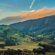 Sunlit Clouds On A Ridge Art Print