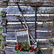 Tall Log Cabin And Garden Tools Art Print by Linda Phelps