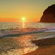 the beach and the Mediterranean sea in Montenegro in the summer at sunset Art Print
