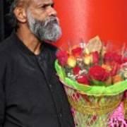 The Flower Vendor - Man Selling Roses Art Print