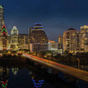 The Glimmering Neon Lights Of The Downtown Austin Skyscrapers Illuminate The Skyline Over Lady Bird Lake Art Print
