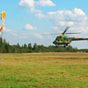 The Helicopter Over A Green Airfield. Art Print
