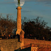 The Moon Rising Behind The Victor Statue In Belgrade In The Golden Hour Art Print